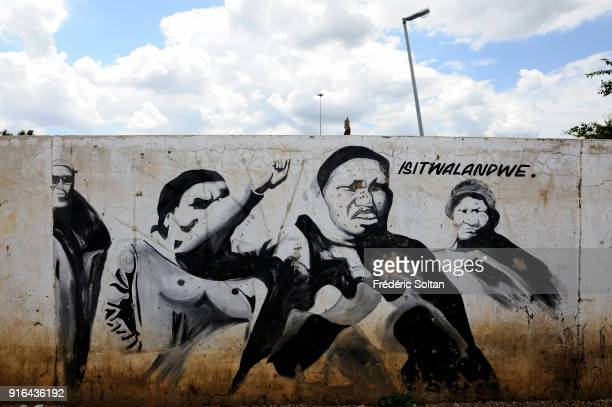 Political and social mural painting and graffitis in Soweto illustrating the women of Soweto who demonstrate because they are alone while their...