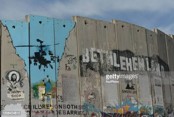 Political and social mural paintings and graffitis on the wall separting Israel and the West Bank in Bethlehem. On Thursday, March 5 in Bethlehem,...