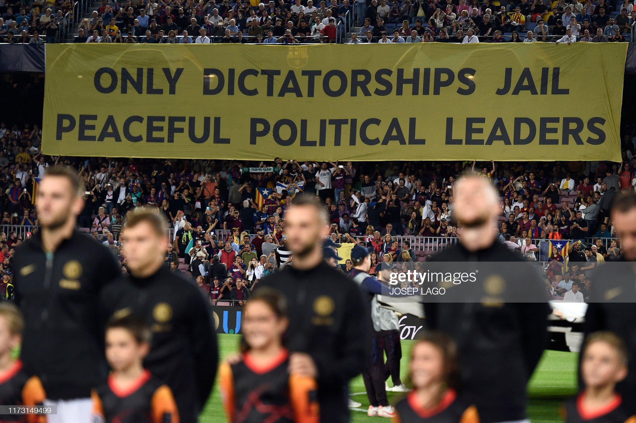 صور مباراة : برشلونة - إنتر 2-1 ( 02-10-2019 )  Political-banner-hangs-from-the-grandstands-during-the-uefa-champions-picture-id1173149499?s=2048x2048