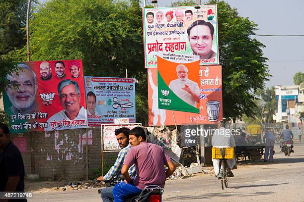 Political banners of various parties displayed on a crossroad for Haryana State Assembly elections 2014 on October 9 2014 in Rohtak India