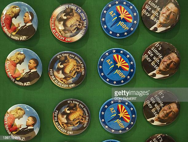 Political buttons are displayed outside the Arizona Federation of Republican Women's Luncheon on February 24 2012 in Scottsdale Arizona The political...