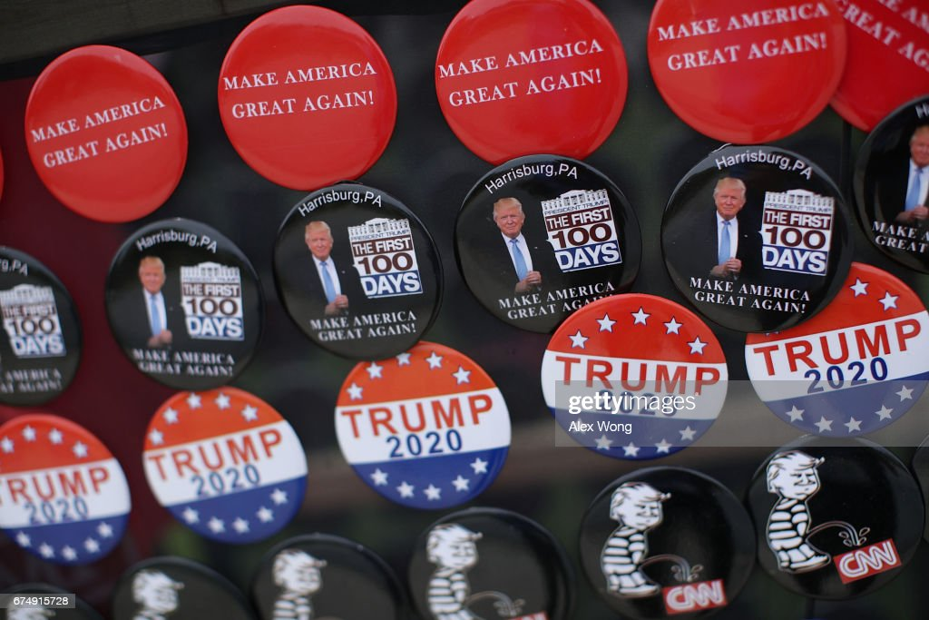 Political buttons are on display at a street vendor outside