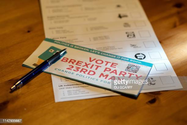 TOPSHOT A political campaign leaflet for 'The Brexit Party' on top of a postal ballot paper for the European parliamentary elections which are...