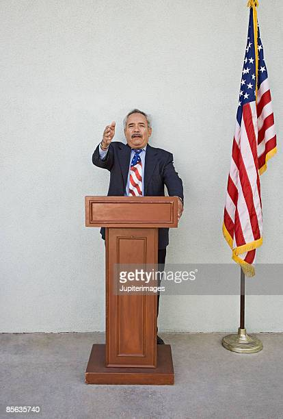 Political candidate at podium giving speech