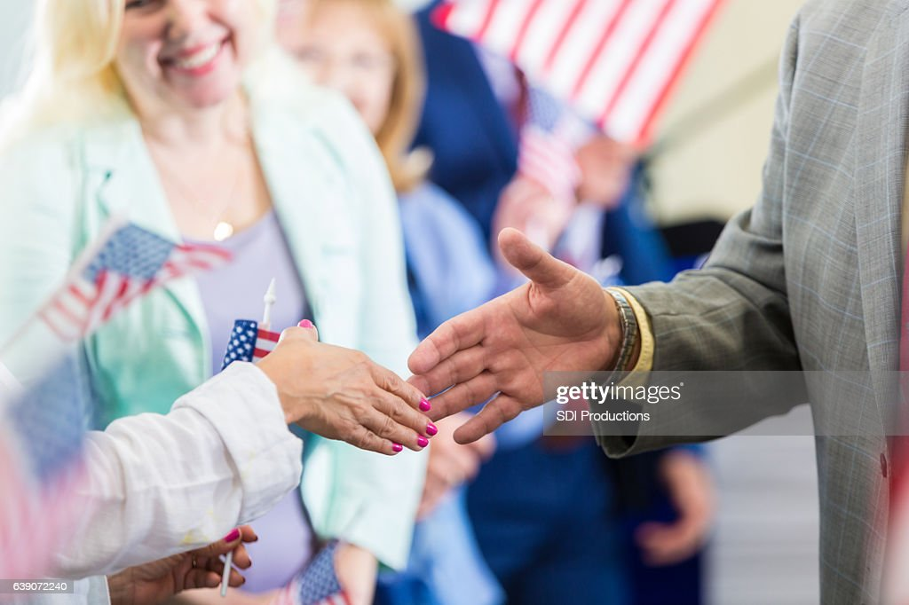 Political candidate greets supporters during rally : Stock Photo