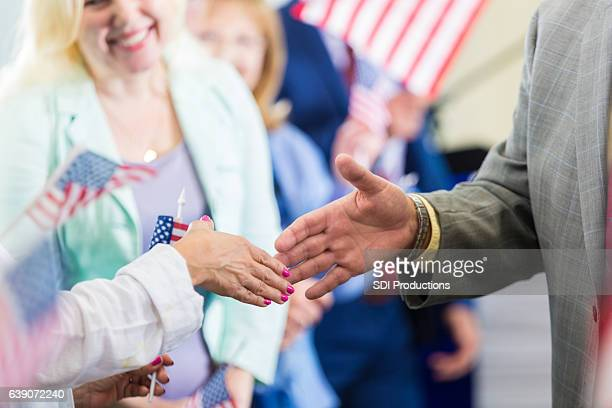 political candidate greets supporters during rally - town hall meeting stock photos and pictures