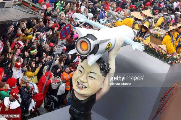 A political caricature float featuring 'North Korean leader Kim Jong Un' takes part in the Rosenmontag  carnival procession in Cologne Germany 12...
