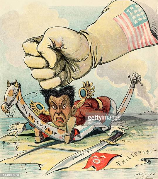 Political cartoon by Halrymple from Puck magazine depicting the great hand of the United States smashing down upon Filipino revolutionary Emilio...