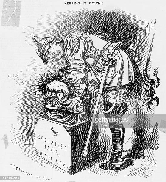 A political cartoon published in Punch magazine shows Otto von Bismarcck struggling with a Socialist jackinthebox