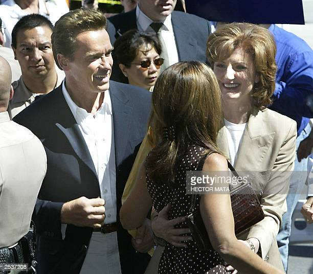 Political comentator Arianna Huffington hugs Arnold Schwarzenegger's wife Maria Shriver as they arrive to the Los Angeles County Registar Office in...