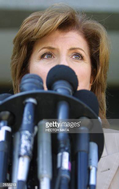 Political comentator Arianna Huffington talks with reporters as she arrives to the Los Angeles County Registar Office in Norwalk CA to register her...