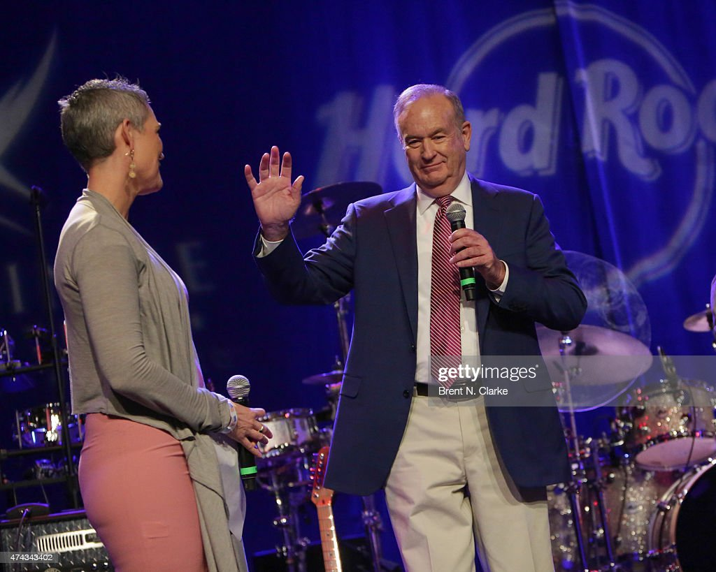 Political commentator Bill O'Reilly (R) speaks on stage as television journalist Jennifer Griffin looks on during the Rock The Boat Fleet Week Kickoff Concert held at Hard Rock Cafe, Times Square on May 21, 2015 in New York City.