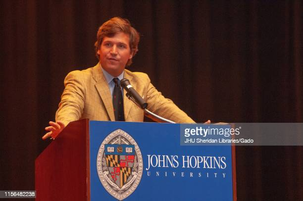 Political commentator Tucker Carlson standing at a podium while speaking during a Milton S Eisenhower Symposium at the Johns Hopkins University...