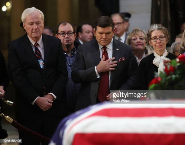 Political commentators Chris Matthews and Bret Baier pay their respects in front of the casket of the late former President George HW Bush as he lies...