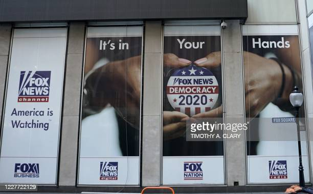 Political display is posted on the outside of the Fox News headquarters on 6th Avenue in New York July 21, 2020. - A female former producer at Fox...