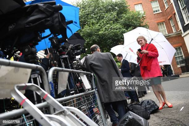 Political editor Laura Kuenssberg waits for Britain's Prime Minister and leader of the Conservative Party Theresa May to deliver a statement outside...