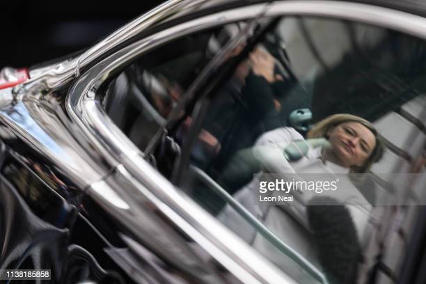 Political editor Laura Kuenssberg's face is reflected in a car window as she waits with other members of the media as ministers leave Downing Street...
