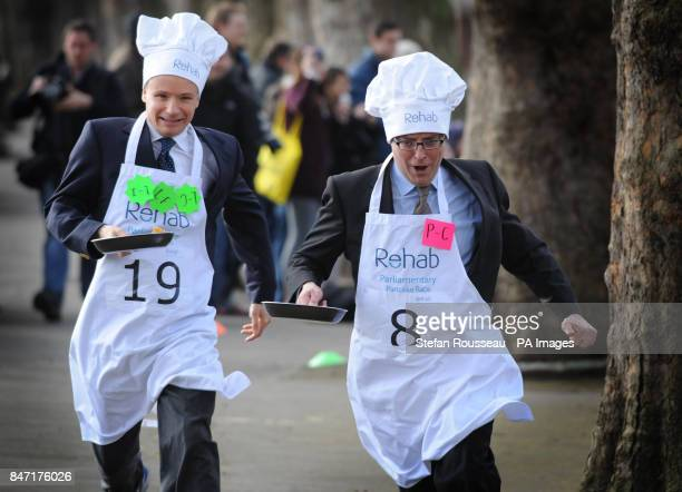 BBC Political Editor Nick Robinson and Lord Listowel take part in the annual Parliamentary Pancake Race in Westminster today raising money for the...