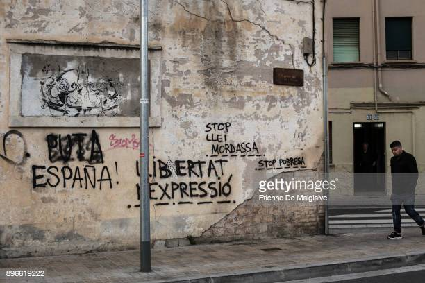 Political graffitis seen on Badalona's street on Election Day on December 21 2017 in Badalona Spain Catalan voters are heading to the polls today to...
