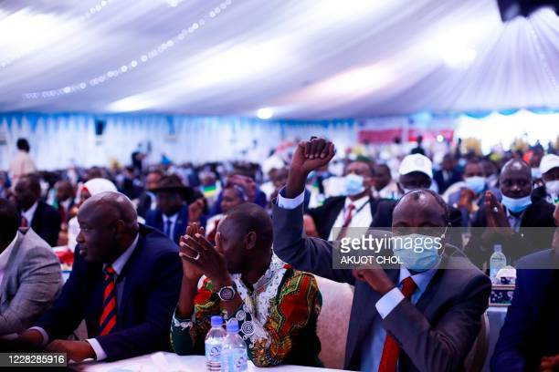 Political leaders cheer during the singing of the Sudan peace deal with the rebel in Juba South Sudan on August 31 2020 Sudanese leaders and rebel...