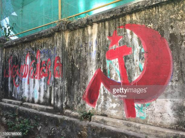 Political messages from one of the communist parties written on a wall in Ambalmkulam Thiruvananthapuram Kerala India