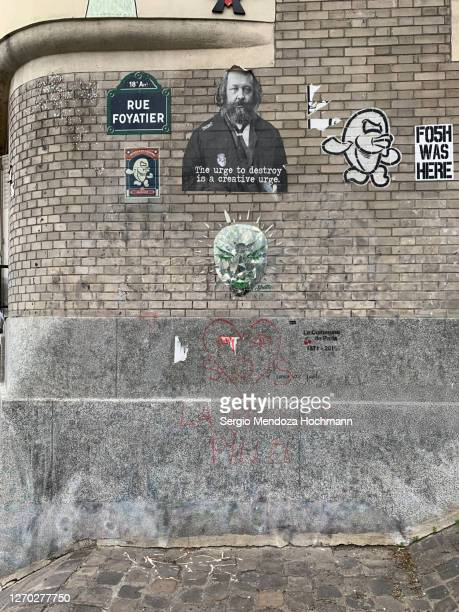 political messages in a building's wall in paris, france - mikhail bakunin stock pictures, royalty-free photos & images