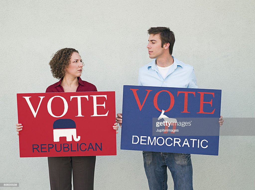 Political opponents holding signs : Stock Photo