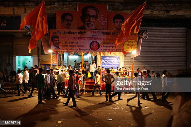 A political party sets up its stall blaring music and speeches from its loud speakers to attract crowds on the final day of the Ganesh Chaturthi...
