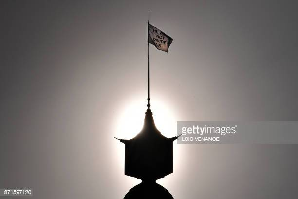 A political piece of art an antiTrump flag flutters at the top of the cultural center Lieu Unique on November 8 2017 in Nantes western France created...