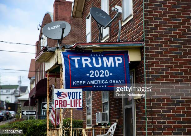 Political posters favoring U.S. Presidential candidate President Donald Trump are attached to an overhang September 11, 2020 in Scranton,...