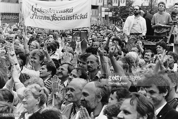 A political rally in Prague Czechoslovakia during the first election since the Velvet Revolution 6th June 1990 In their midst is a banner for the...