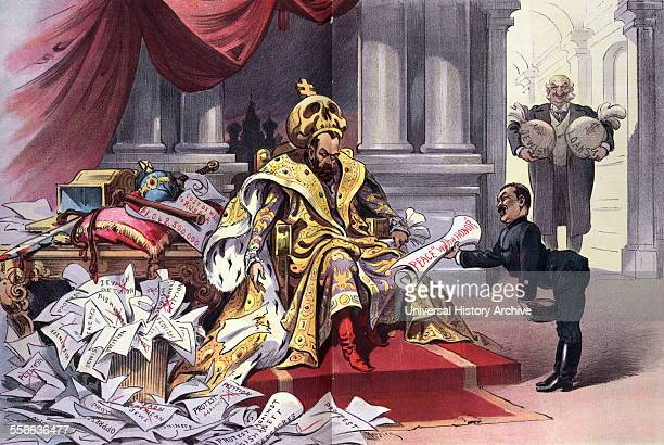 Political satire depicts Nicholas II emperor of Russia sitting on a throne wearing a large skull topped with a cross as a crown whilst a Japanese man...