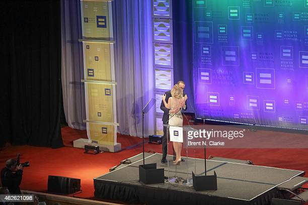 Political strategist and author Margaret Hoover greets Human Rights Campaign President Chad Griffin on stage during the 2015 Human Rights Campaign...