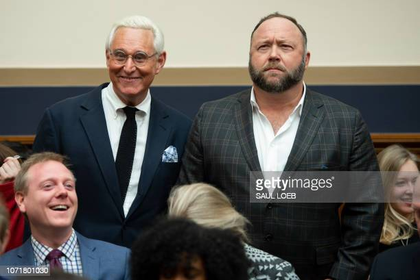Political Strategist Roger Stone and commentator Alex Jones arrive to hear testimony by Google CEO Sundar Pichai during a House Judiciary Committee...