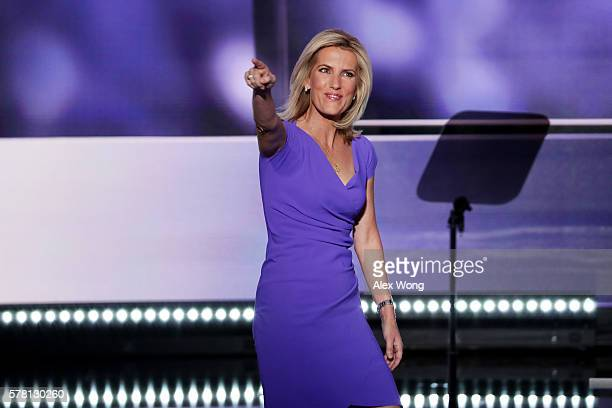 Political talk radio host Laura Ingraham gestures to the crowd as she walks on stage to deliver a speech on the third day of the Republican National...
