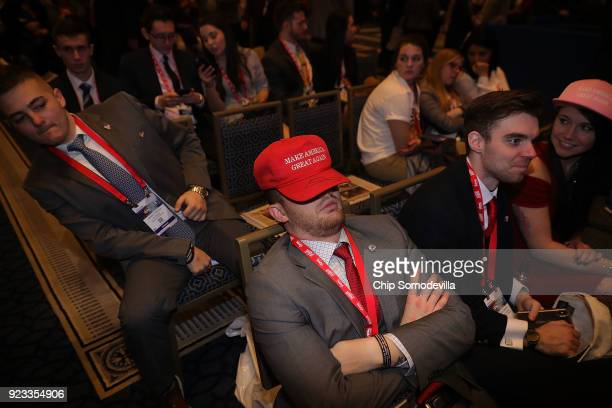 Politically conservative people one wearing a red 'make america great' hat arrive early at the Conservative Political Action Conference at the...
