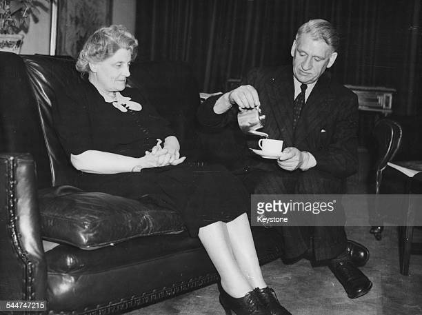 Politician Alfred Edwards, recently expelled from the Labour Party after criticizing the government, pouring his wife a cup of tea as they attend the...