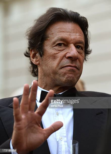 Politician and former cricketer Imran Khan attends a reception hosted by Prince Charles Prince of Wales and Camilla Duchess of Cornwall for the...