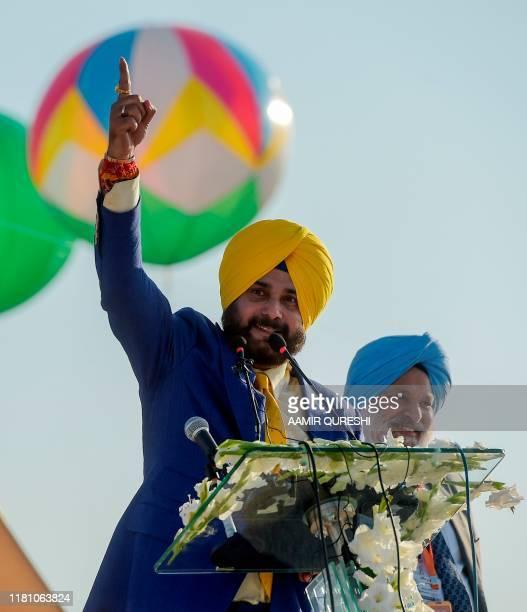 Politician and former cricketer Navjot Singh Sidhu speaks during a ceremony at the Shrine of Baba Guru Nanak Dev at Gurdwara Darbar Sahib in...