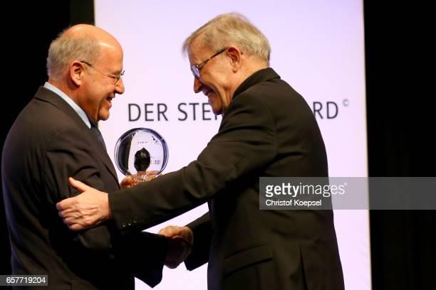 Politician and laudatio speaker Gregor Gysi honours Walter Kardinal Kasper for the tolerance award during the Steiger Award on at Coal Mine Hansemann...