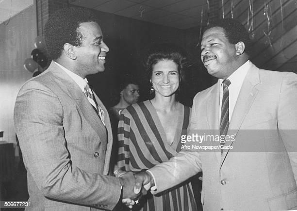 Politician and Maryland congressional representative Elijah Cummings shaking hands, 1984.