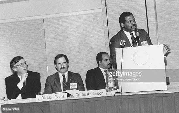 Politician and Maryland congressional representative Elijah Cummings speaking at a podium 1988