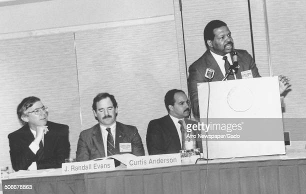 Politician and Maryland congressional representative Elijah Cummings speaking at a podium, 1988.