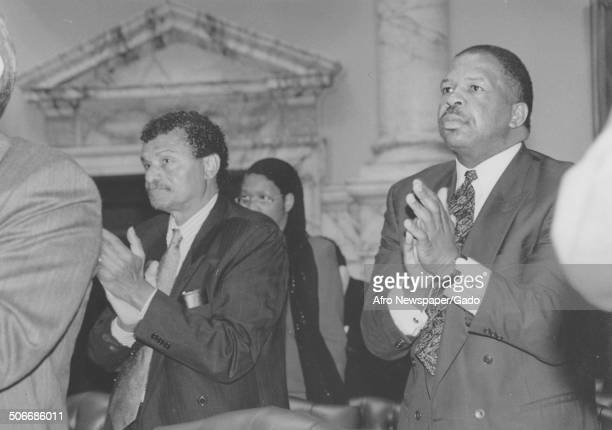 Politician and Maryland congressional representative Elijah Cummings clapping 1984