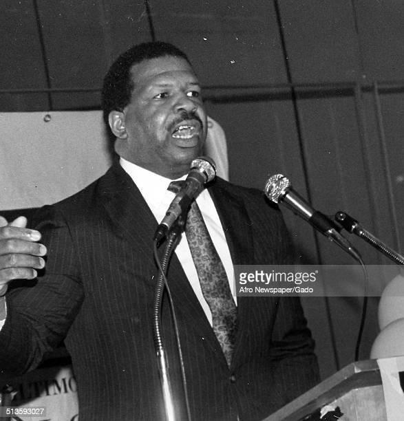 Politician and Maryland congressional representative Elijah Cummings speaking at a podium 1985