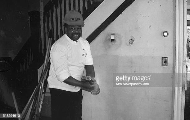 Politician and Maryland congressional representative Elijah Cummings wearing hardhat 1998