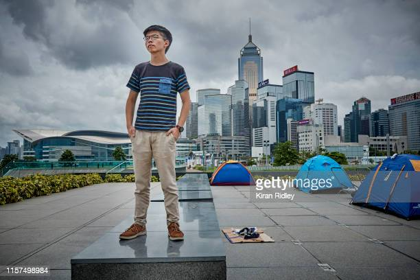 Politician and student activist Joshua Wong photographed nearby some protestors camp near the Hong Kong Government Building's on June 19, 2019 in...