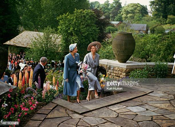 Politician and tennis player Lady Domini Crosfield goes into tea with her guest, Princess Elizabeth , during one of the annual tennis parties given...