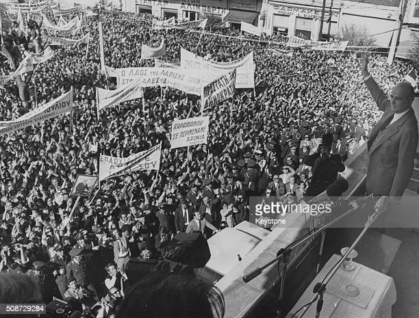 Politician Andreas Papandreou waving from a balcony following the fall of the Greek military Junta during a political rally 1974