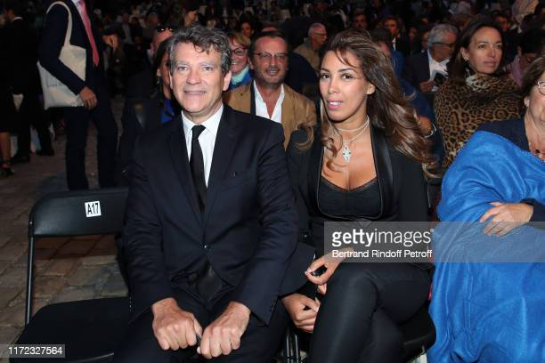 Politician Arnaud Montebourg and his companion Amina Walter attend the Tosca Opera en Plein Air performance at Les Invalides on September 04 2019 in...
